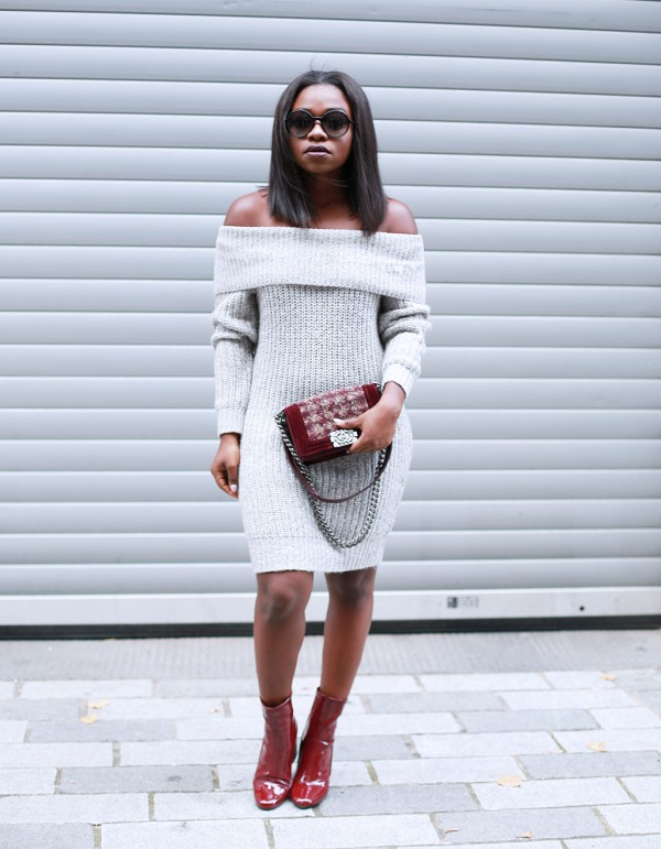 Fisayo-Longe-Grey-Off-the-Shoulder-Knit-Dress-Burgundy-Boots-Matching-Handbag-OnGiselleAve